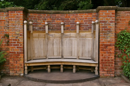 I would love a walled garden with a bench like this